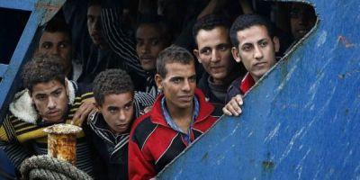 Germania va prelua lunar sute de migranti blocati in Italia