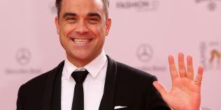 Robbie Williams apare nud pe coperta unei reviste dedicate homosexualilor